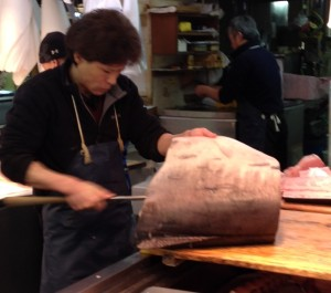 Worker filleting swordfish